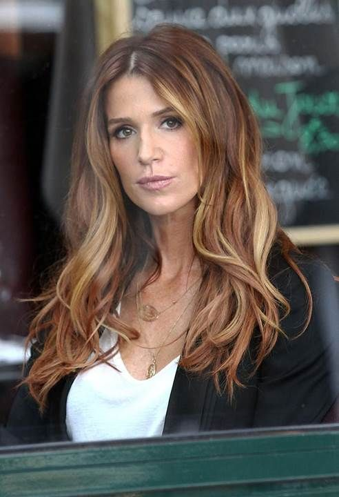 "Star of the television show ""Unforgettable,"" Poppy Montgomery has hair that we can't help but remember. Poppy's red hair is proof positive that sombre is for every hair color. Poppy's red sombre color makes you just want to head to the hairdresser and try it for yourself. Face framing highlights run through tousled waves confirming that Poppy has one gorgeous head of hair. Sombre does for red hair what ombre just couldn't do."