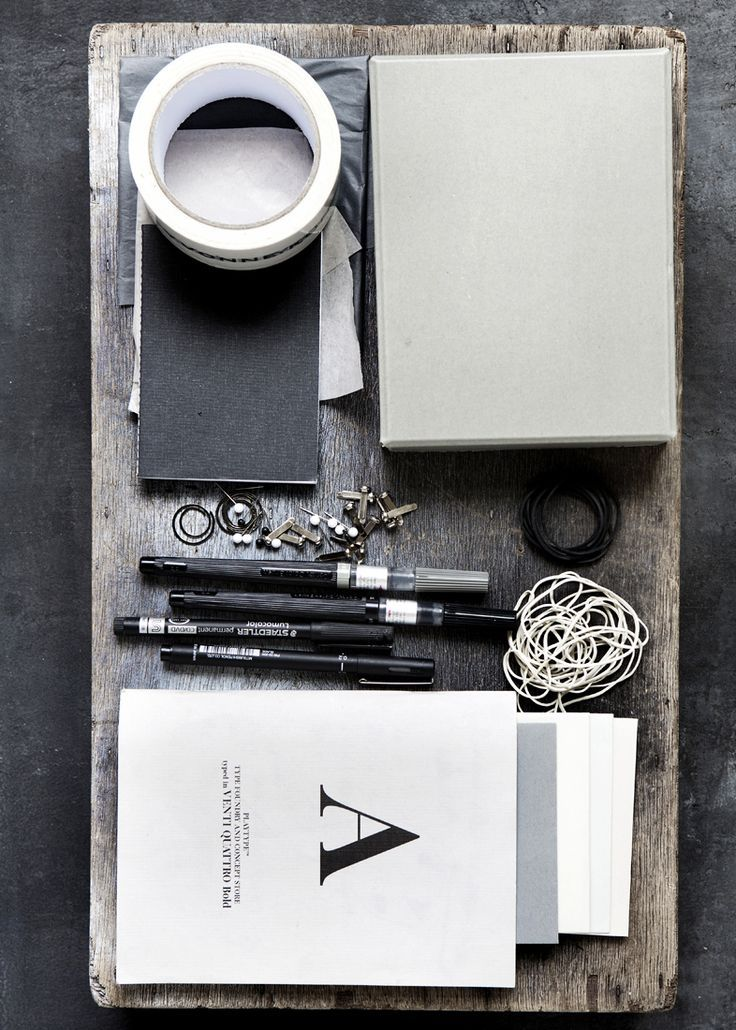 pens, notebooks, wooden table