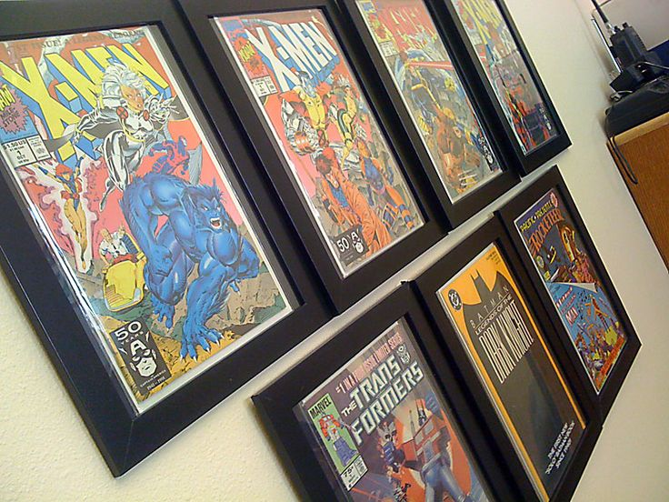 I want to do this... I just need some wall space. Comic display wall in simple black frames.