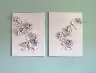 Beautiful Canvas Project. Simply attach faux flowers to a canvas and spray paint a bright white.