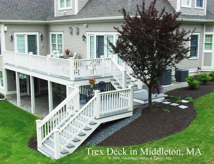 "@Kim Bosman Ray Two story deck for walk out basements...  Beautiful and it doubles your ""deck"" space too and provides covered shelter for rainy days too."