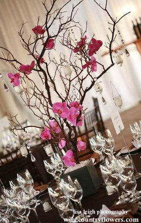 manzanita branches with orchids, crystals, and votives