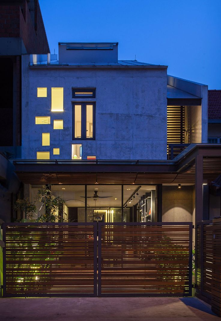 HabitatMY - Modern terrace house designed with off form concrete and timber by hyla architects
