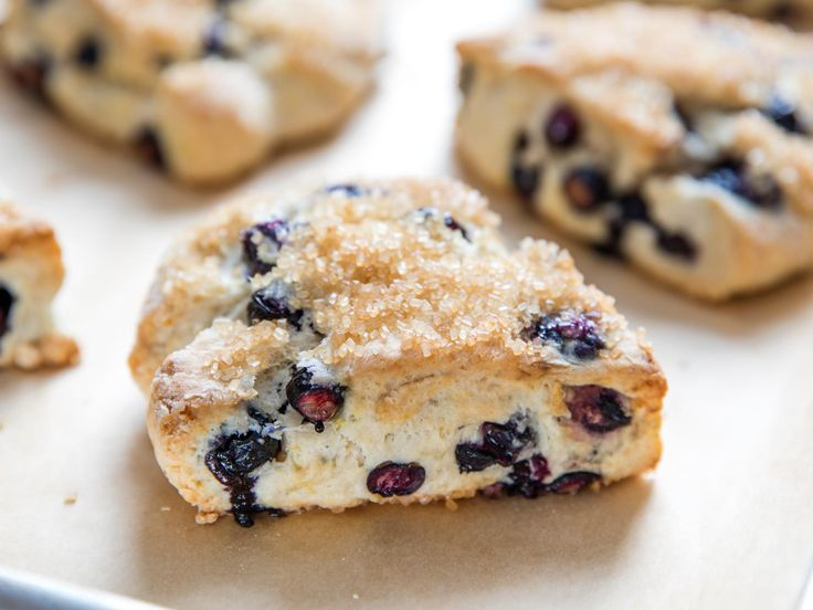 Lemon Blueberry Scones | The bulk of sugar in this recipe for lemony scones comes from a sprinkle of turbinado on top, an entirely optional (though delightfully crunchy) addition. The dough itself leans on fresh blueberries for sweetness, with just two teaspoons of sugar to help with flavor and browning. #dessertrecipes #sconerecipes #lemonrecipes #desserts #lowsugar
