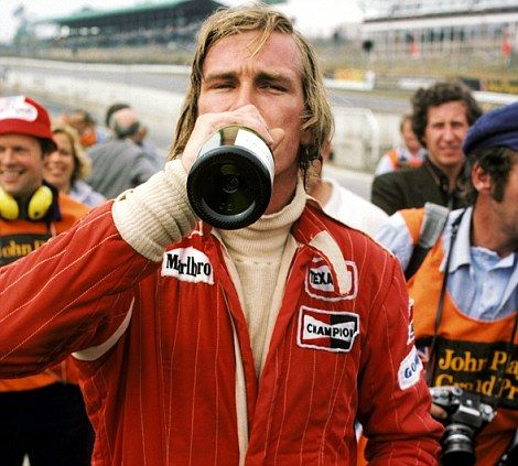 James Hunt swigs from a bottle of champagne