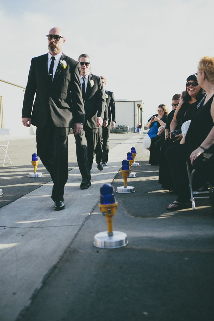 Handcrafted runway lights made by the couple for their aviation themed wedding