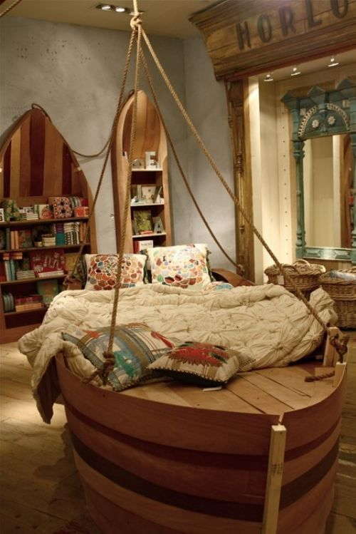 So cool! Love the nautical theme of this kids room - especially the bookshelves so cute for a beach house