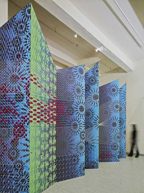 This jagged wall decorated with patterned graphics was designed to invite visitors into an art fair in New York City