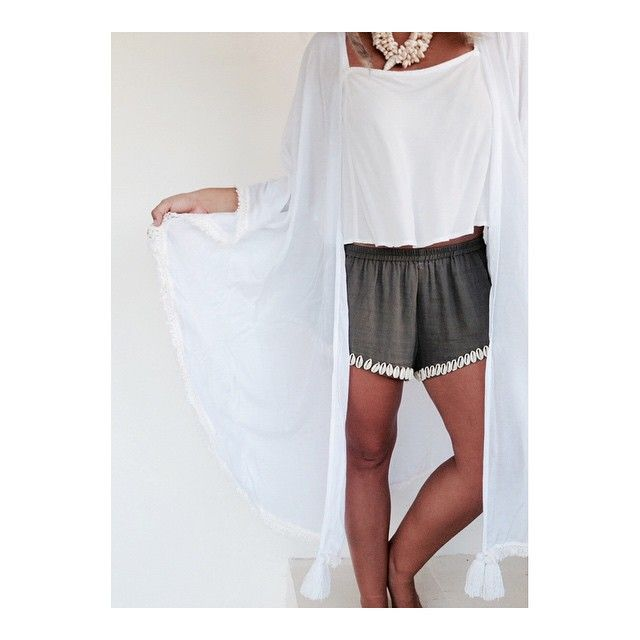 n e w tassel cape in white + cowrie shell shorts + white crop • all available on etsy x.