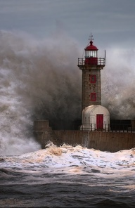 That is an amazing picture with the wave crashing against the lighthouse