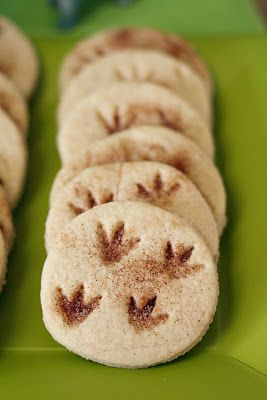 LOVE THESE!! Fossil Cookies  Use your  BEST sugar cookie recipe, rolling it out and cutting it into circles, take a {washed} dino and made foot prints, then take a little cinnamon sugar concoction, and sprinkled in the foot prints. Baked and done.