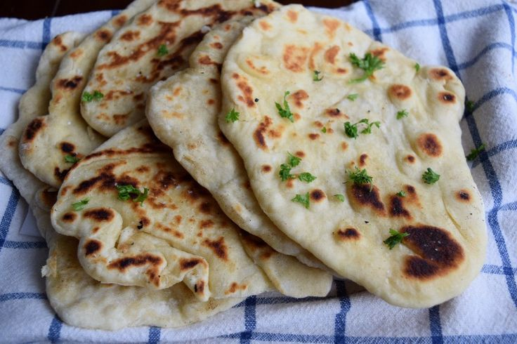 Soft, buttery, pillowy Naan Bread {homemade & easy} that is simple, deliciousand made on a skillet. Sign me up! Bread. Where would we be without glorious delicious carby bread? Seriously think about it. Bread is everywhere and it would be a sad sad world without bread. One bread that I have always been beyond excitedRead more
