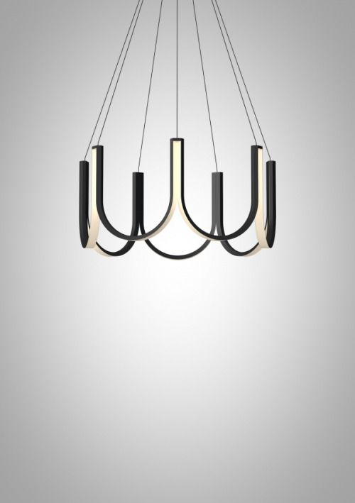 The U Series of lamps is a creation of Sylvain Willenz for the lighting specialist Arpel. The series consists of a single U shaped lamp either in black or white, that can be used as a single pendant lamp, a long line of curves, or arranged in a circle as a minimalistic but still impressing chandelier.