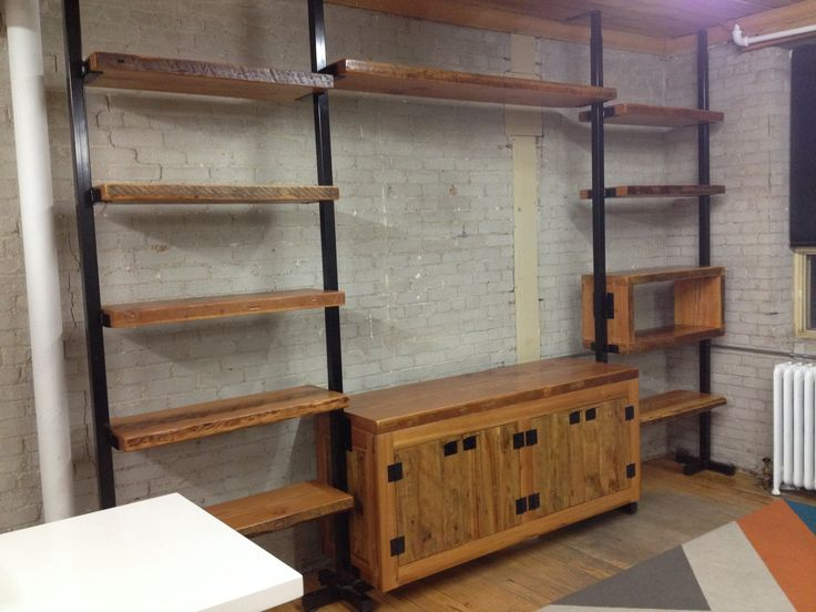 13 ft tree shelf complete with opening for a wide screen TV. built in lower cabinet and ample shelf space
