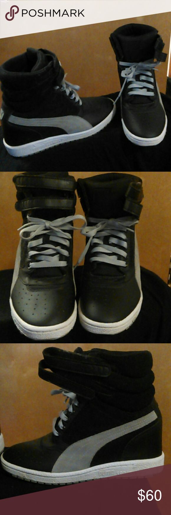 Puma leather and suede high top wedge sneakers Black and grey leather and suede high top Puma wedges. Normal wear and in good condition. No scratches or scuffs in the leather. Puma Shoes