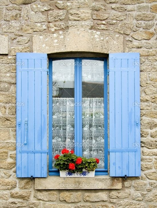 Traditional French window with shutters. Fishing village, Brittany, Western France by LongGone