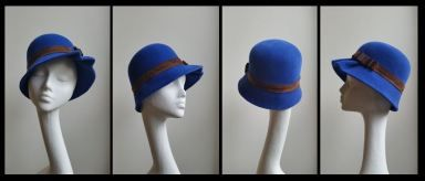 Fluted cloche > Royal blue velour felt with a brown leather band and small bow