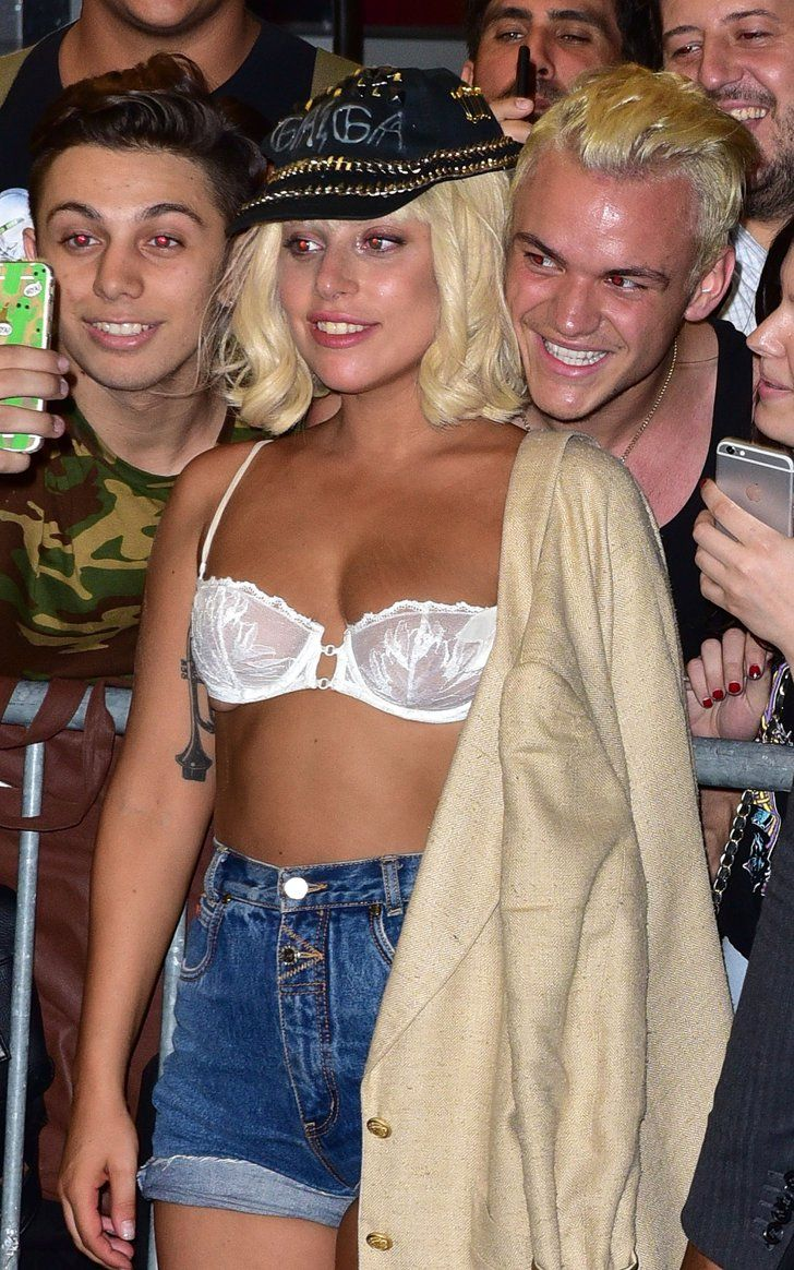 Pin for Later: Lady Gaga Puts Her Underboob on Display in a White Bra  Still, the star posed with fans and draped her beige jacket over her shoulder.