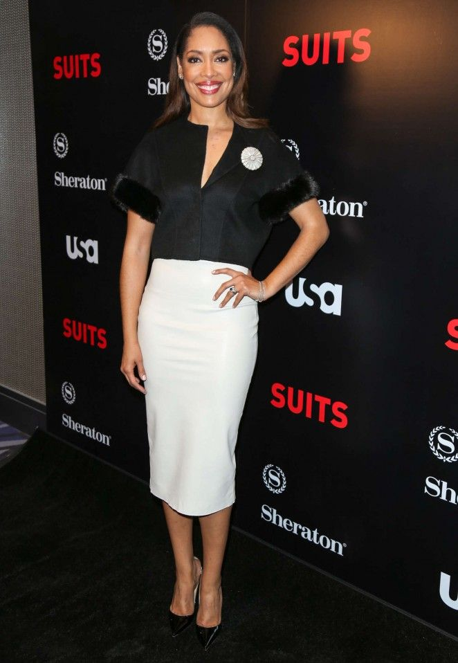 Gina Torres was also on hand at the Suits Season 5 Premiere in a black cropped jacket with fur trim-sleeves, a white pencil skirt, and black pumps. Hot!