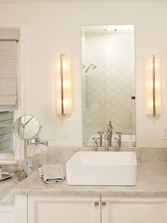 Harry Braswell Inc: Lovely master bathroom design with polished nickel modern sconces flanking frameless ...