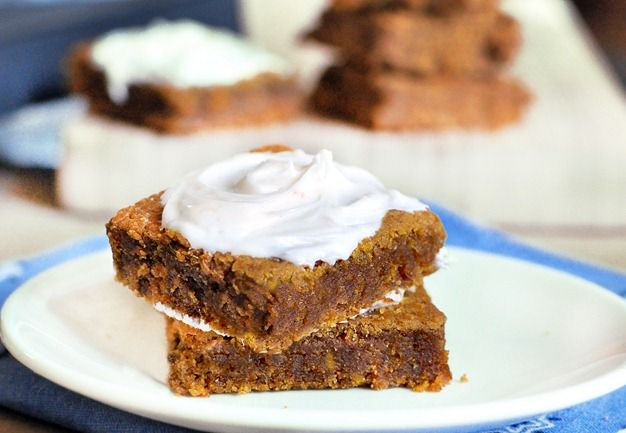 Soft and moist homemade pumpkin bars, with just a few basic ingredients and no oil whatsoever! You won't be able to stop at just one, trust me! Find out how to make them here:  http://chocolatecoveredkatie.com/2011/09/23/pumpkin-cream-cheese-bars/