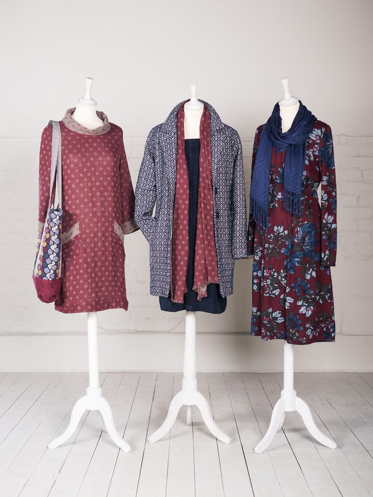 Three casual knee length dresses in patterned red, navy blue with textured jacket and red and white floral by Nomads Clothing.