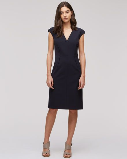 New to the Paris range is this cap-sleeved dress, made from a virgin wool mix. Beautifully tailored inside and out, the dress has a V-neckline and darts which have been stitched on the outside of the garment for obvious visibility, providing a neat shape. It also includes full lining and a concealed zip closure. Partner with our range of tailored jackets or spring coats.