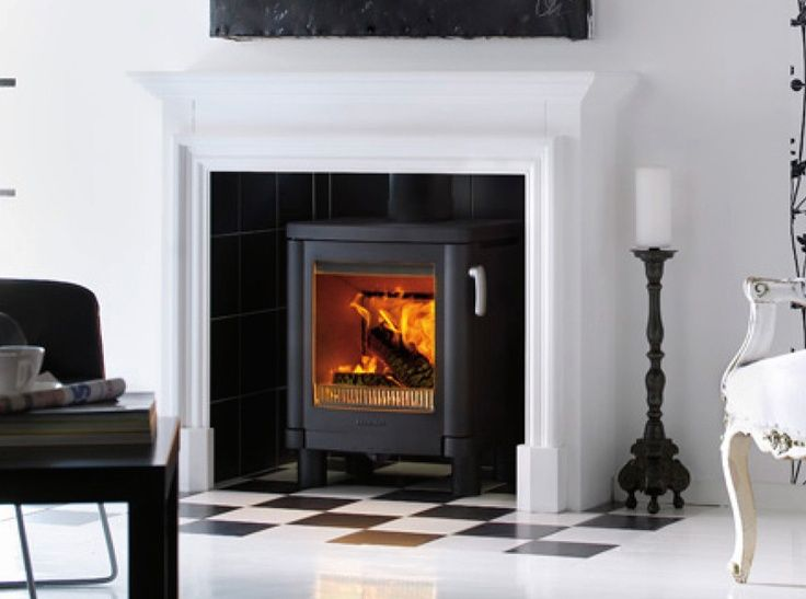 Small Living Room Ideas with a cast iron fireplace | The Handol 51 is a modern cast iron stove with convection air. It has ...
