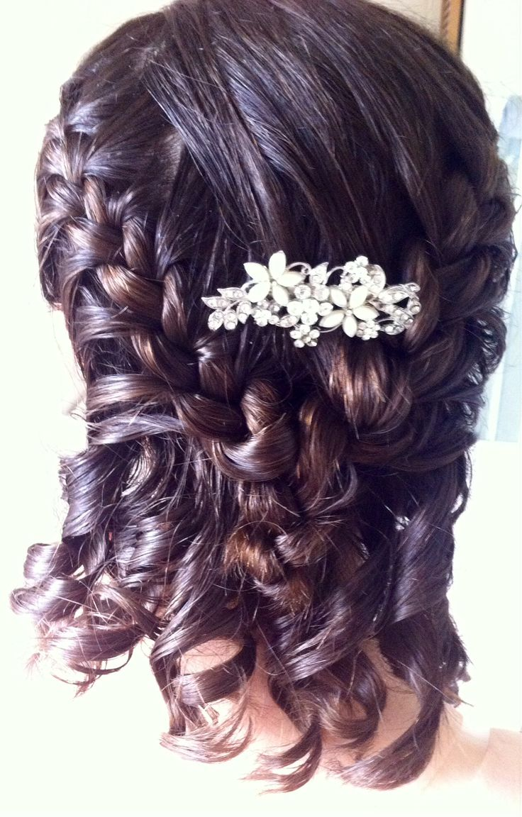 I did my Sister's hair for a wedding, and I'm quite proud of how it turned out! French plait each side towards a point at the centre of the back of the head, then plait together. Pin the end up behind the plait to hide the bobble, curl the remaining hair and for a final elegant touch add and secure a slide just above the plait...