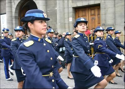 Policewomen walk past the rostrum to be reviewed while attending the 175th anniversary of Uruguay's Constitution Oath Taking Day.