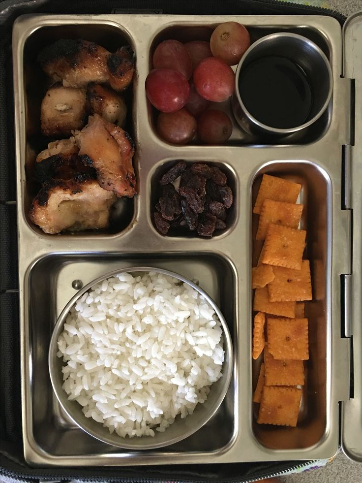 Teriyaki chicken, rice, brags, grapes and cheese it's. With a side of miso soup.