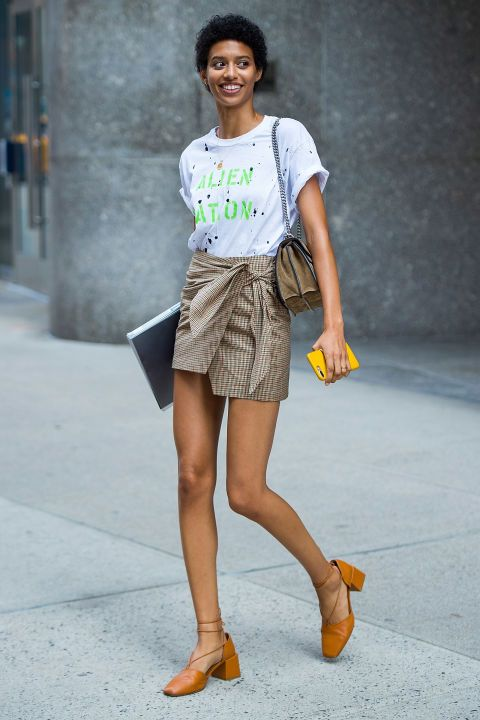 Jourdana Phillips paired a statement tee with a tartan mini skirt and block-heeled shoes.