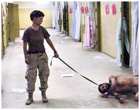 Baghdad — A photo obtained by the Washington Post and released Thursday, May 6, 2004, shows a soldier identifed as U.S. Army Spc. Lynndie England, 21, of the 372nd Military Police Company with a naked detainee at the Abu Gharib prison.