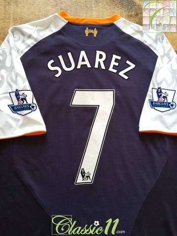 f61868a9a Complete with Suarez  7 on the back of the shirt in official Lextra  lettering