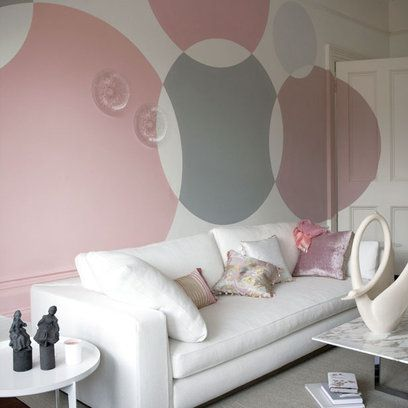 The classic pairing of soft grey and pink is normally demure but not when painted in giant circles on the wall. For an even bigger statement, don't stop at the walls - let the circles wheel across the doors too. The result is irrepressibly energetic and joyous.