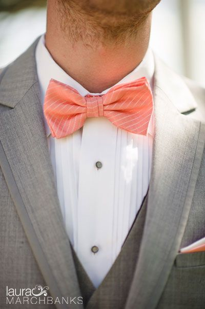 Groom is styled in a fun striped coral bow tie and light grey three piece suit.  Seattle Wedding Photographer Laura Marchbanks Photography captures a wedding at Rosario Resort and Spa in Eastsound on Orcas Island