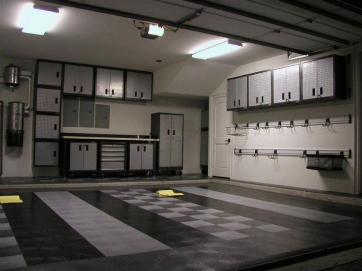 Garage cabinets, black and grey tile flooring, lots of storage.