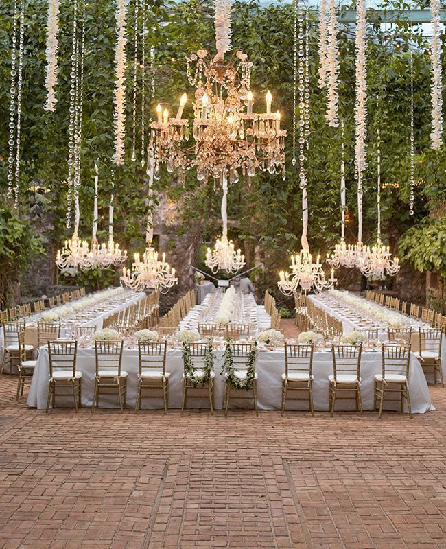 suspended chandeliers, beautifully long tables, and a killer outdoor space make this so over the top.