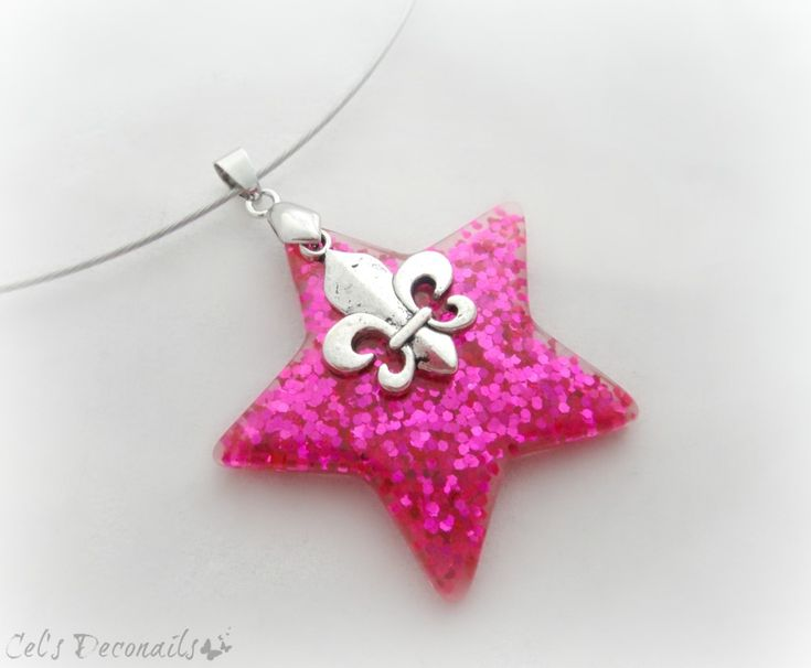 A super kawaii and sparkly pink glitter star pendant with a silver fleur de lis charm hanging on top. A unique and eyecatching necklace full of kawaii bling. It hangs from a silver aluminum wire.  All items ship carefully packaged in bubble wrap envelopes by registered mail. Tracking number an...