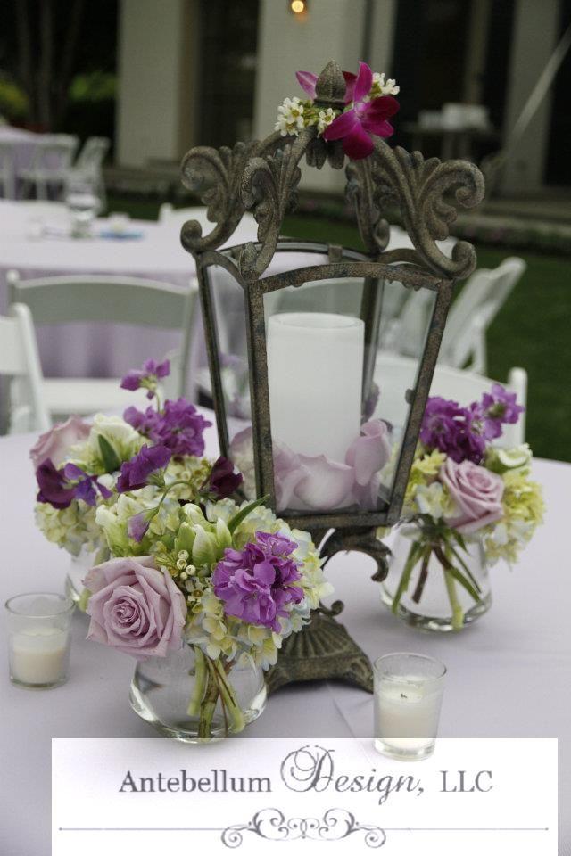 Purple Wedding Flowers Around A Romantic And Rustic Lantern Reception Centerpiece By