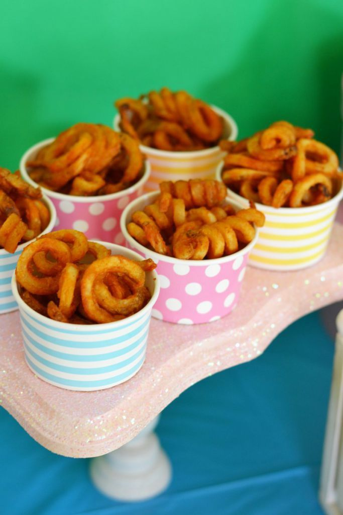 "During your little one's Peppa Pig birthday bash, serve curly fries in colorful personal-sized servings. You can even call them ""pig tails!"""