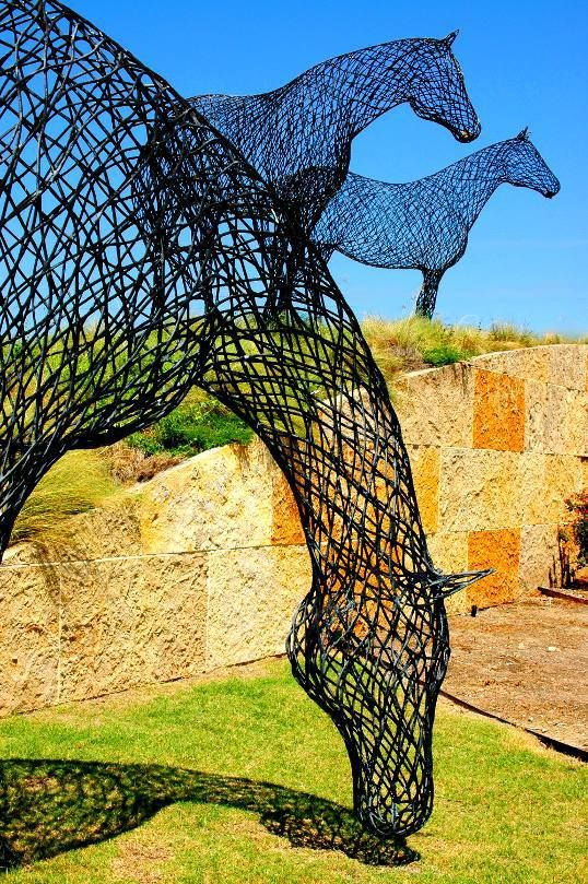 Steel Horses sculpture by Peter Busby;  at Austin Ranch, Plano, Texas - photo by Bill Chance