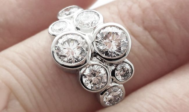 Modern cluster rings are often styled around new and exciting concepts. The diamond bubble ring is one such design, supersized to include 2cts of diamonds