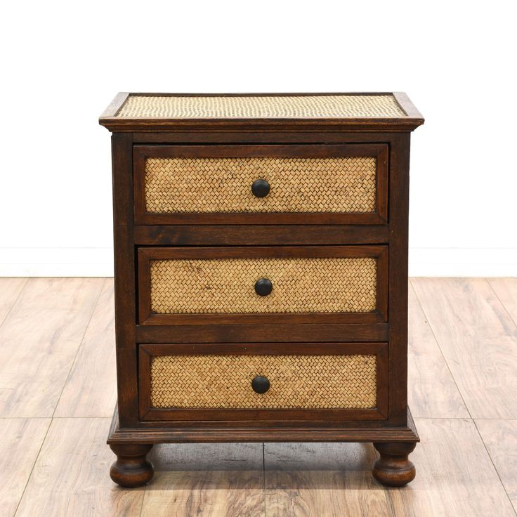 This nightstand is featured in a solid wood with a glossy rosewood finish. This Asian style bedside table has 3 spacious drawers, woven rattan panels, and crown moulding details. Perfect for storing nighttime necessities! #asian #dressers #nightstand #sandiegovintage #vintagefurniture