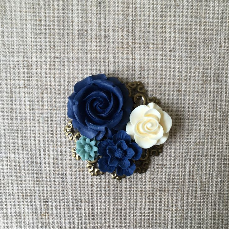 A personal favorite from my Etsy shop https://www.etsy.com/listing/235130510/wedding-broochboutonniere-with-dark-blue