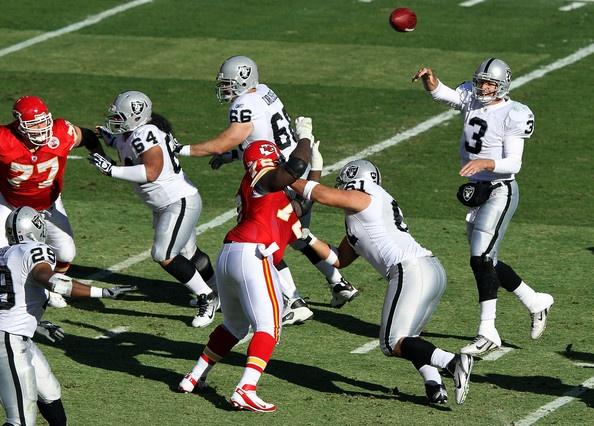 Quarterback Carson Palmer #3 of the Oakland Raiders passes during the game against the Kansas City Chiefs on December 24, 2011 at Arrowhead Stadium in Kansas City, Missouri.