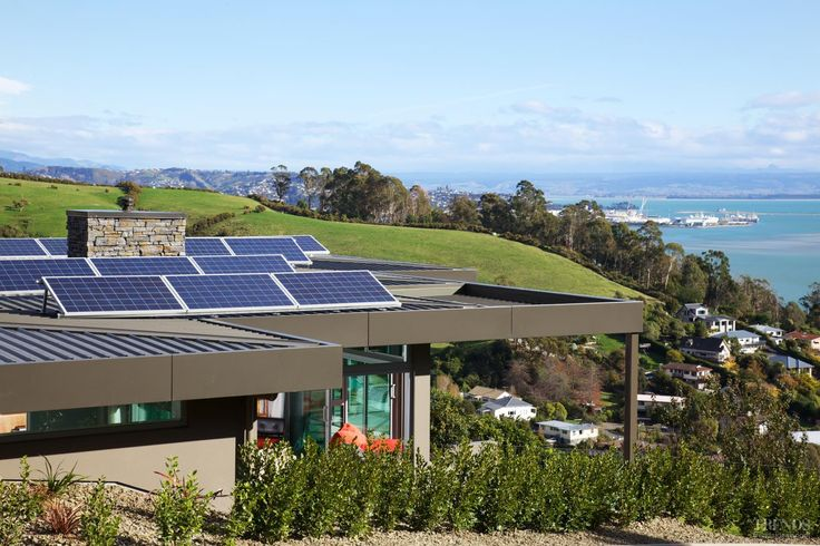 Several eco-friendly factors were introduced in the design and construction of this house. These include an array of photovoltaic panels to capture the sun's energy and convert it into electricity.
