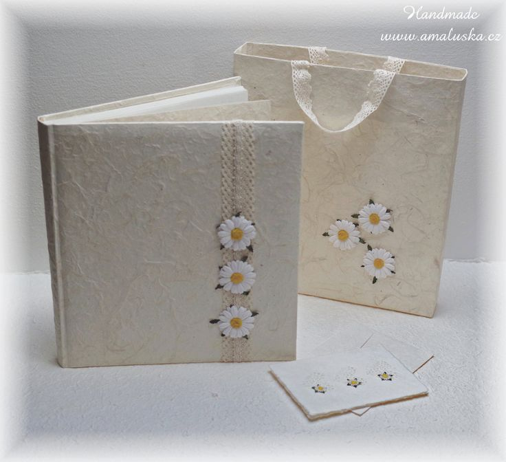 Wedding photo album with handmade paper laces and flowers.