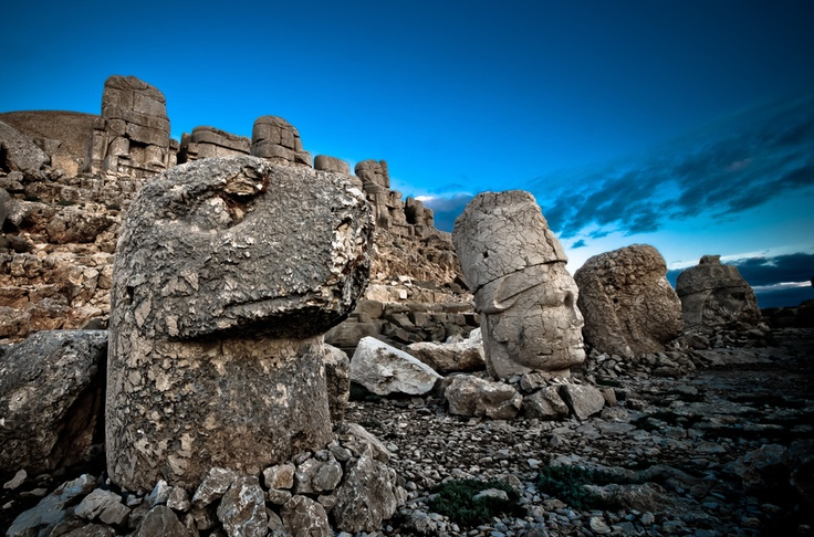 Nemrut Dağı (Turkey). 'One man's megalomania echoes across the centuries atop Nemrut Dağı's exposed and rugged summit. A gently emerging sunrise coaxes stark shadows from the mountain's giant sculpted heads, and as dawn breaks the finer details of the immense landscape below are gradually added. Huddling against the chill of a new day, a warming glass of çay (tea) could not be more welcome.' http://www.lonelyplanet.com/turkey/central-anatolia/nemrut-dagi-national-park