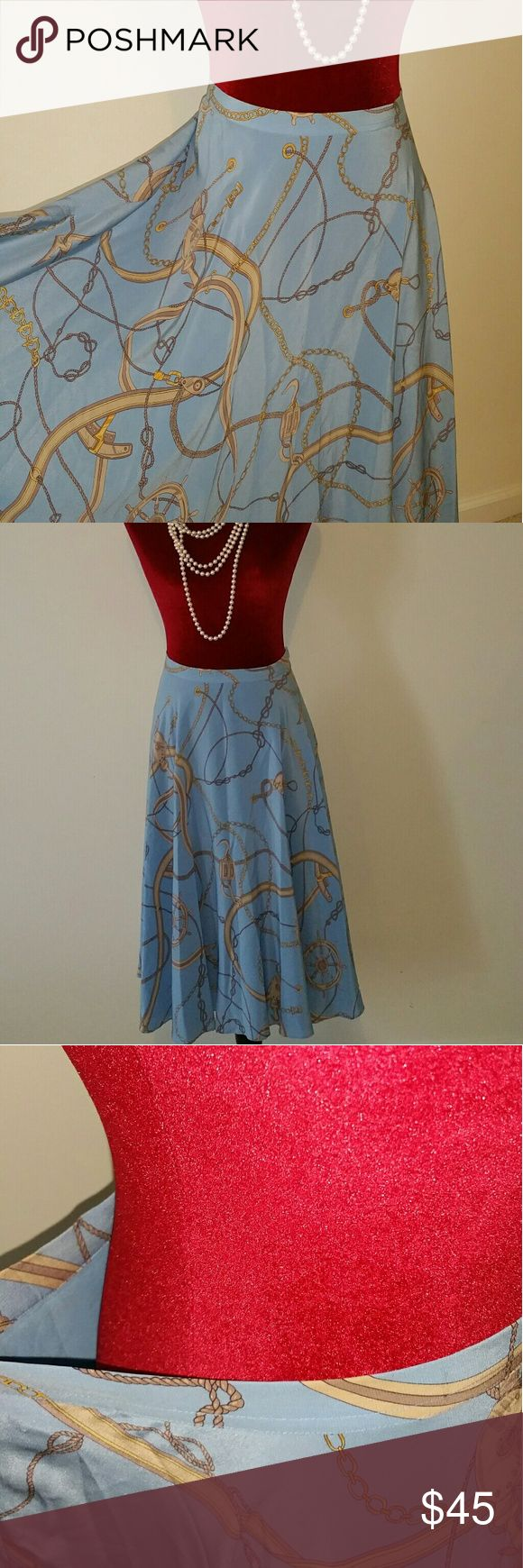 👗NAUTICA 100% SILK SKIRT Size 8👗 👗Gorgeous Aqua Blue 100% Silk Skirt. Size 8. Lining is 100% Polyester. Dry Clean Only. Clean. Waist is 15.5 inches. Length is 27 inches.Pre-Loved. Colors: Aqua Blue. Cream. Gold. Decoration is chain links with hooks. Tiny hole near zipper (see photo). 👗Please view all photos 👗Make an Offer 👗Let's Chat Nautica Skirts